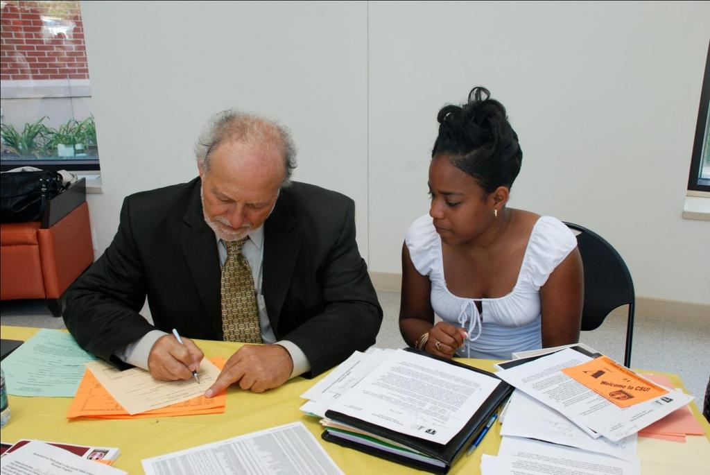 Dr. Frank Schiraldi, Director of The Center for Academic Success advises student with her schedule. The Center for Academic Success (TCAS) Library (lower level) Room 35 (937) 376-6419 Dr.