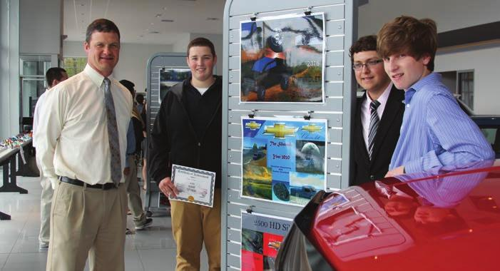 FoundationHighlights PRHS Teacher Jeff Maple is shown here with some students at the Pine-Richland Opportunities Fund fundraiser with Tom Henry Chevrolet.