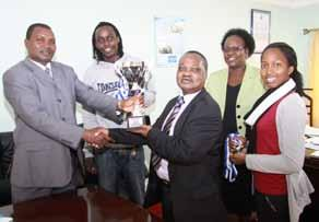 Henry Mutoro, Deputy Vice-Chancellor academic affairs recieves Prof.