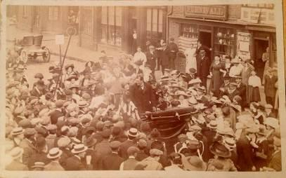 1910 1910 Sir Ernest Craig speaking in Sandbach on the Market Square a number of pictures show him talking from the back of a carriage outside some shops on the Market Square.