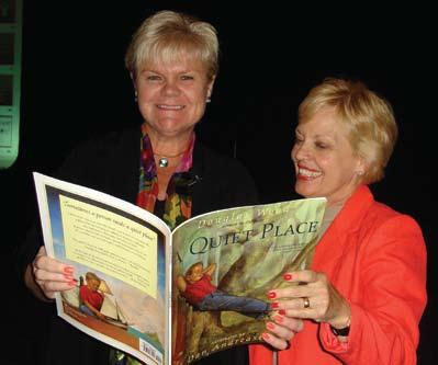 Symposium Focuses on Reaching Learners on Different Levels Maureen McLaughlin, left, a member of the International Reading Association board of directors, shares a book with Debbie Hardwick-Smith,