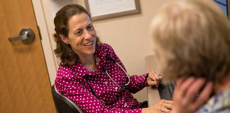 3. PATIENT CARE Anne Niebler, MD, talks with her patient at the Cottage Grove Clinic.