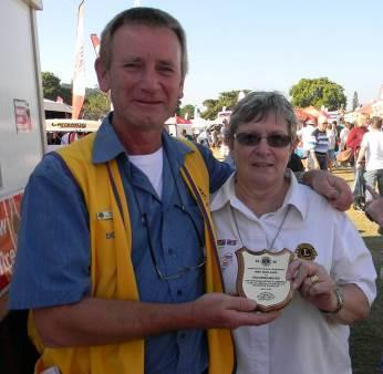 OUT AND ABOUT WITH THE DISTRICT GOVERNOR Past District Governor Denis Meyer was presented with an appreciation award by District Governor Heather Hardman on