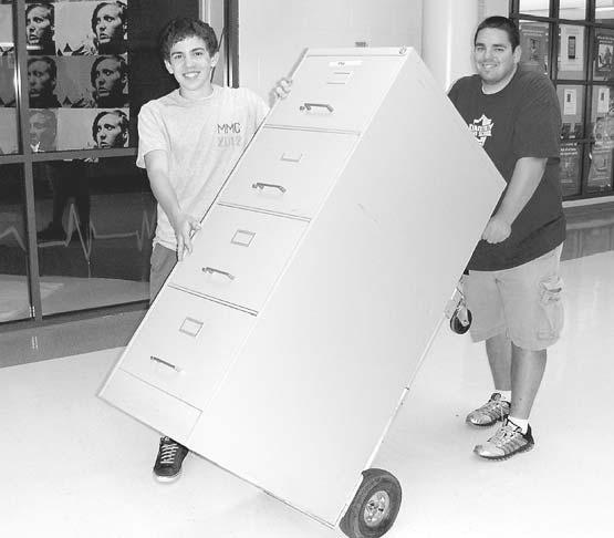 Photos by Bonnie Hobbs/Centre View News Chantilly sophomore Joey Lisko (on left) helps Associate Band Director Chris Singleton move a filing cabinet down the hall.