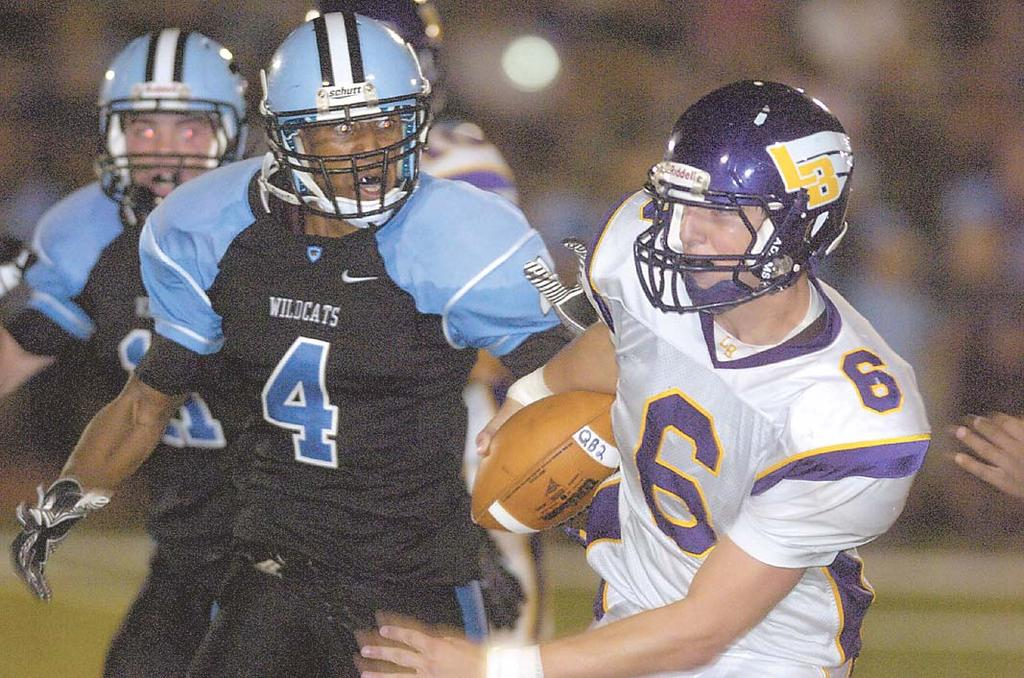 Photos by Craig Sterbutzel/Centre View Sports Centreville s Xavier Nickens-Yzer (4) chases after Lake Braddock quarterback Caleb Henderson. Centreville running back Taylor Boose scores a touchdown.